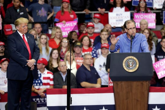 President Donald Trump listens as Senate candidate Mike Braun speaks at a campaign rally at the Allen County War Memorial Coliseum in Fort Wayne, Ind., Monday, Nov. 5, 2018. (AP Photo/Michael Conroy)