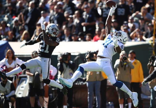 Indianapolis Colts tight end Mo Alie-Cox (81) catches a pass for a touchdown against Oakland Raiders cornerback Gareon Conley (21) during the first half of an NFL football game in Oakland, Calif., Sunday, Oct. 28, 2018. (AP Photo/Ben Margot)