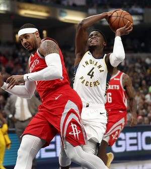 Indiana Pacers guard Victor Oladipo (4) drives on Houston Rockets forward Carmelo Anthony (7) in the first half of their game at Bankers Life Fieldhouse on Nov. 5, 2018.