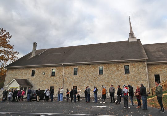 A line of voters stretches outside the Chinese Community Church polling site in Hamilton County, for midterm the election, Tuesday, Nov. 6, 2018.