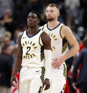 Indiana Pacers guard Darren Collison (2) and Domantas Sabonis (11) walk off the court following their game against the Houston Rockets at Bankers Life Fieldhouse on Nov. 5, 2018.