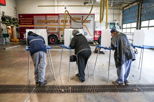 Voters fill in their ballots inside of the Indianapolis Fire Department's Station 1 on Tuesday, Nov. 6, 2018.