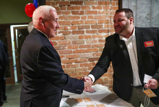 Republican Greg Pence, a candidate for Indiana's 6th Congressional District, shakes hands with volunteer Dale Buwalda during an election night gathering for Bartholomew County Republicans and their supporters at the Factory 12 Event Lofts in Columbus, Ind., on Tuesday, Nov. 6, 2018.