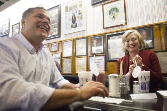 Former Secretary of State Hillary Clinton enjoys a pie shake with Democratic Senate candidate Rep. Bruce Braley during a brief stop at Hamburg Inn on Wednesday, Oct. 29, 2014.