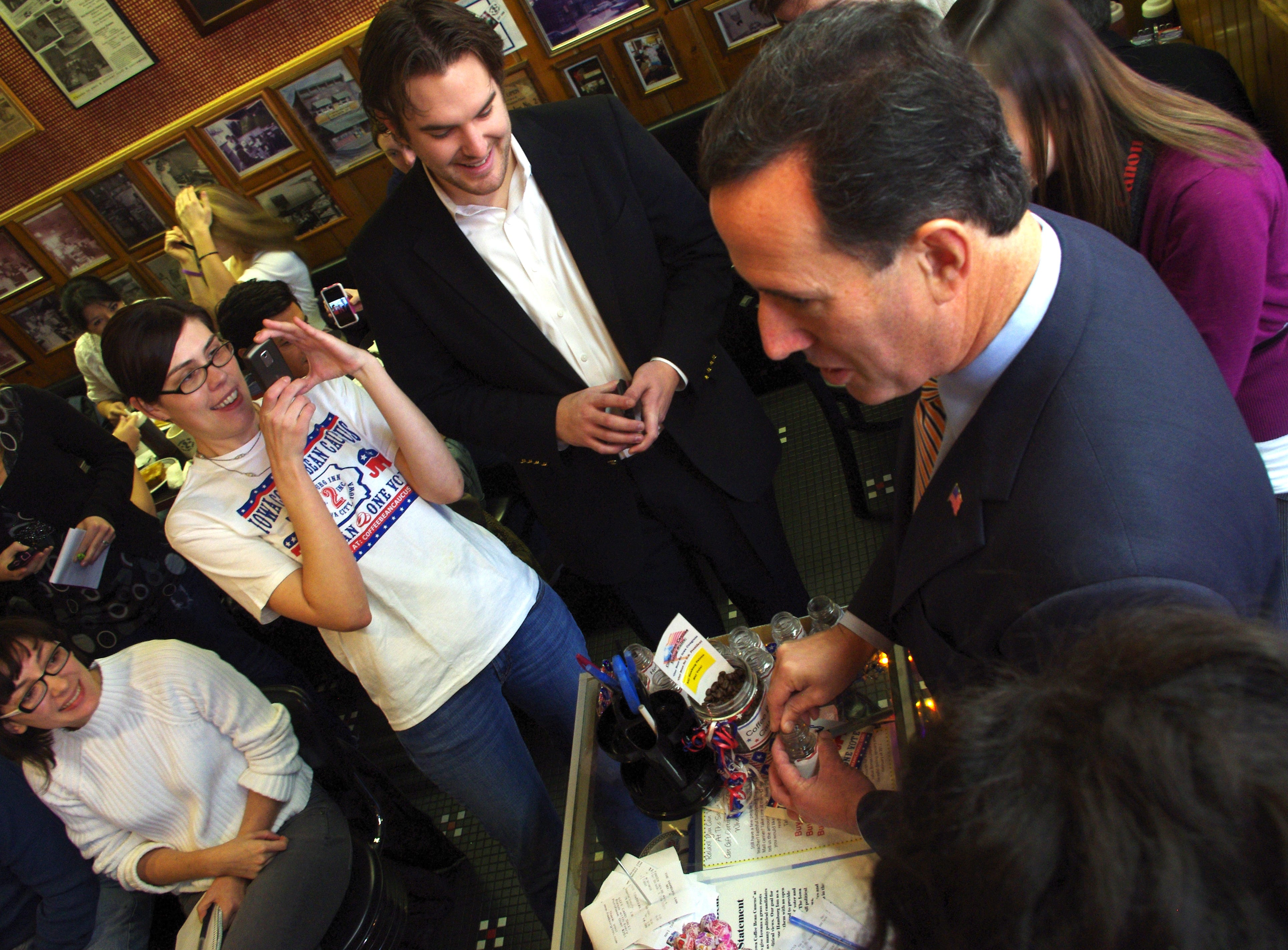 Republican presidential candidate Rick Santorum shakes hands with and greets Iowans Thursday, Nov. 17, 2011, at the Iowa Coffee Bean Caucus at the Hamburg Inn. Santorum said his leadership in the Senate and House of Representatives speaks for itself in making him a viable candidate.