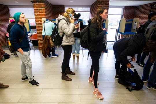 Students wait in line to vote inside Iowa City precinct 11 on Tuesday, Nov. 6, 2018, at the University of Iowa Main Library in Iowa City.