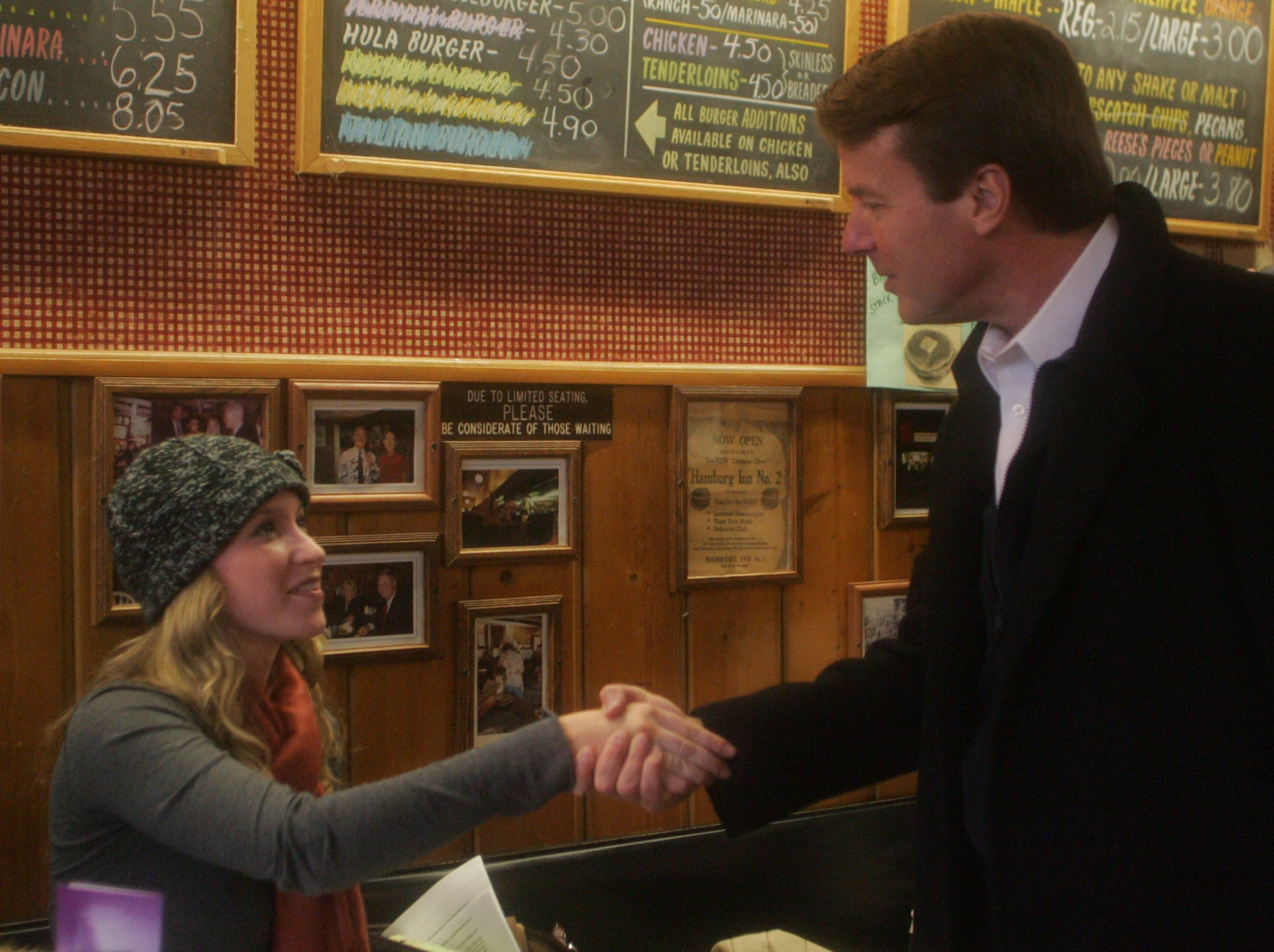 Democratic presidential hopeful John Edwards, right, shakes hands with Margaret Jennings during a quick stop at the Hamburg Inn No. 2 in Iowa City on Tuesday, Dec. 11, 2007.