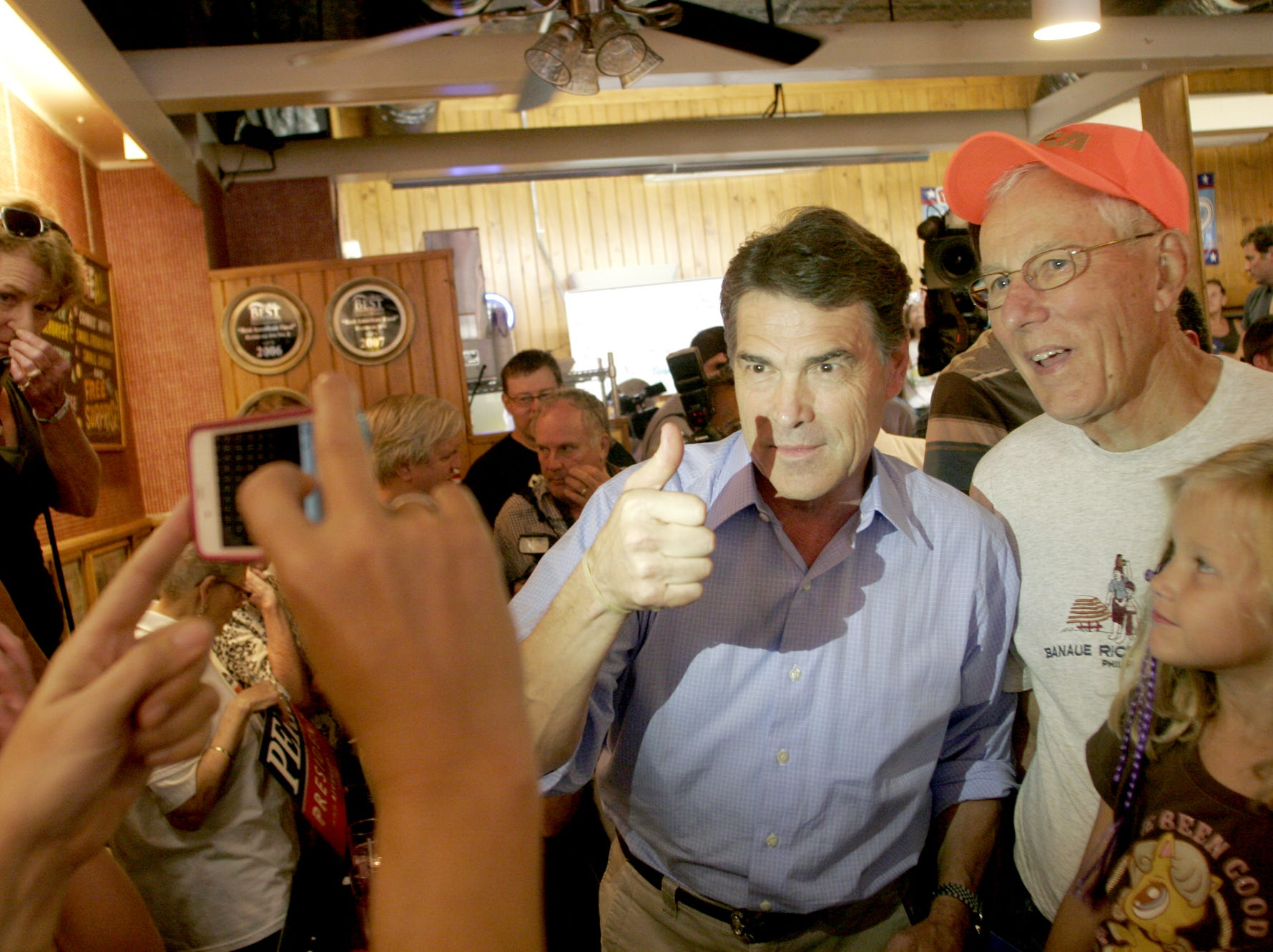 Current Texas Governor and 2012 presidential candidate Rick Perry poses for a picture during a stop at the famed Hamburg Inn on Linn Street near downtown Iowa City, IA on Monday, August 15, 2011.