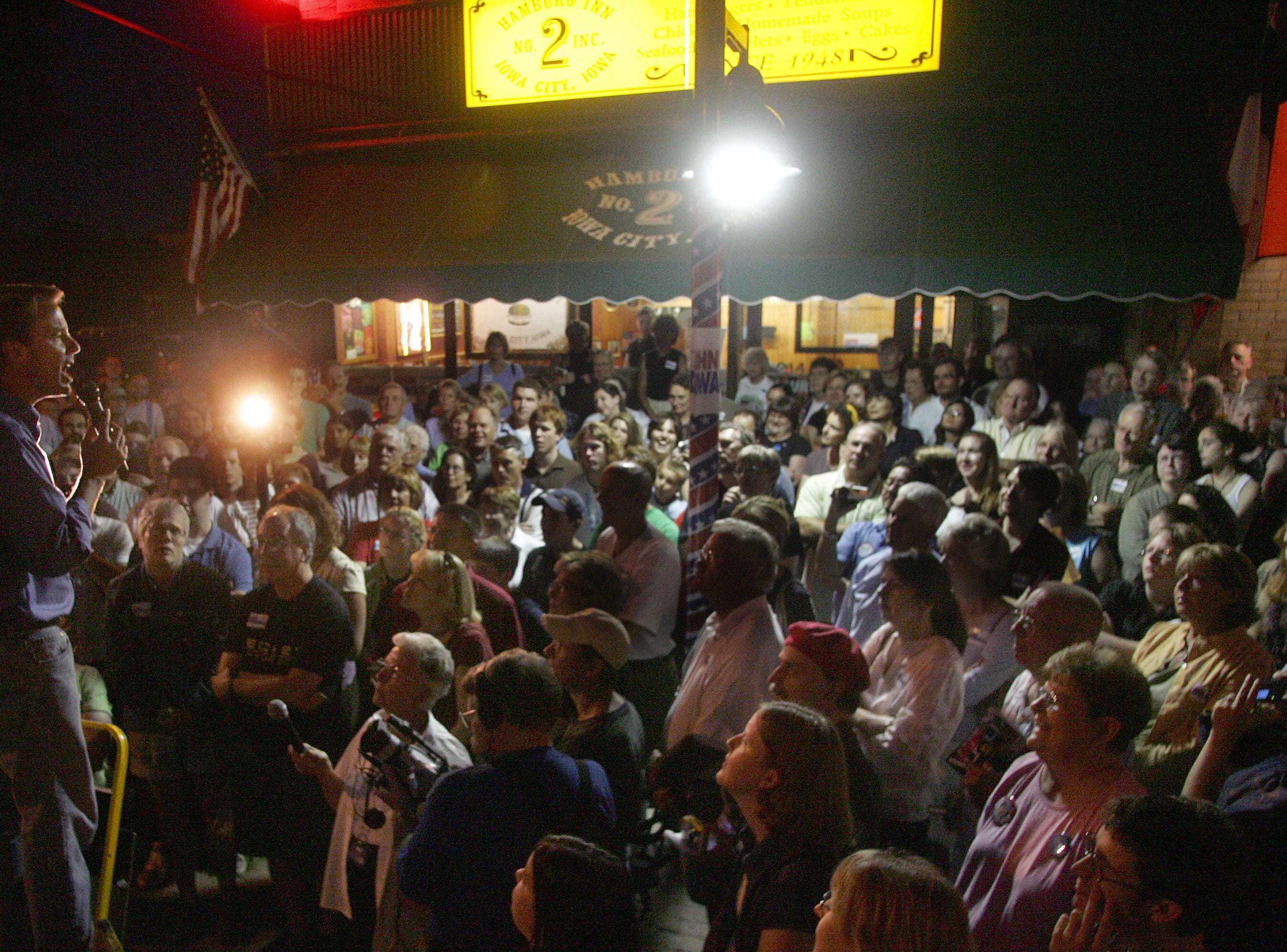 Former U.S. Senator and Democratic Presidential hopeful John Edwards spoke to a group of a few hundred gathered in front of Iowa City landmark the Hamburg Inn No. 2 Friday night August 17, 2007.