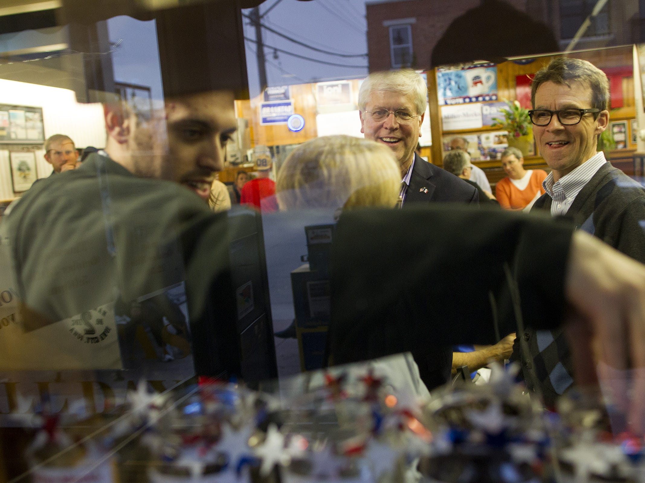 Democratic gubernatorial candidate Jack Hatch checks coffee bean caucus jars at Hamburg Inn on Thursday, Oct. 30, 2014.