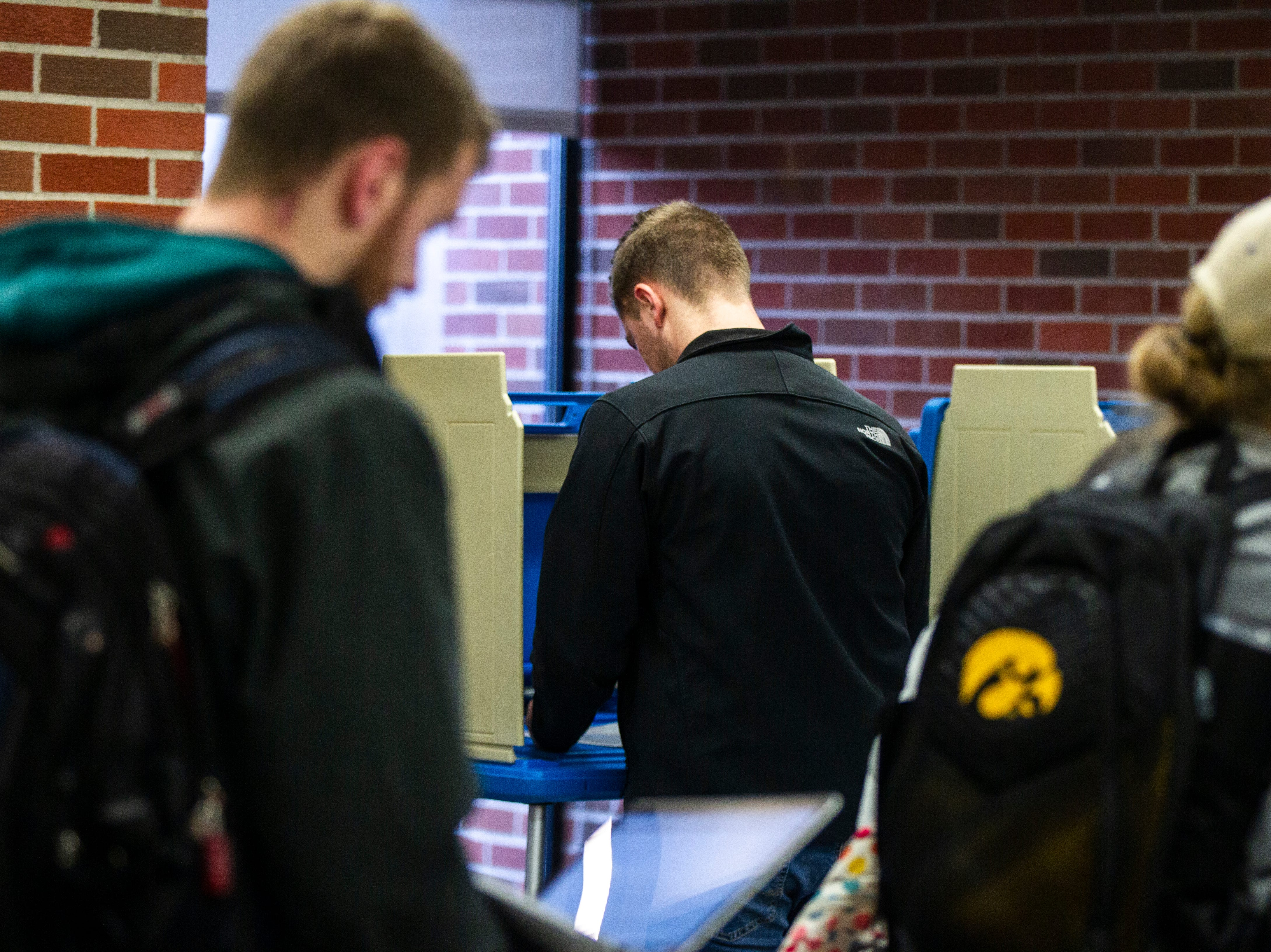 Students vote inside Iowa City precinct 11 on Tuesday, Nov. 6, 2018, at the University of Iowa Main Library in Iowa City.