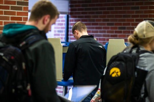 Students vote inside Iowa City precinct 11 on Tuesday, Nov. 6, 2018, at the University of Iowa Main Library in Iowa City.