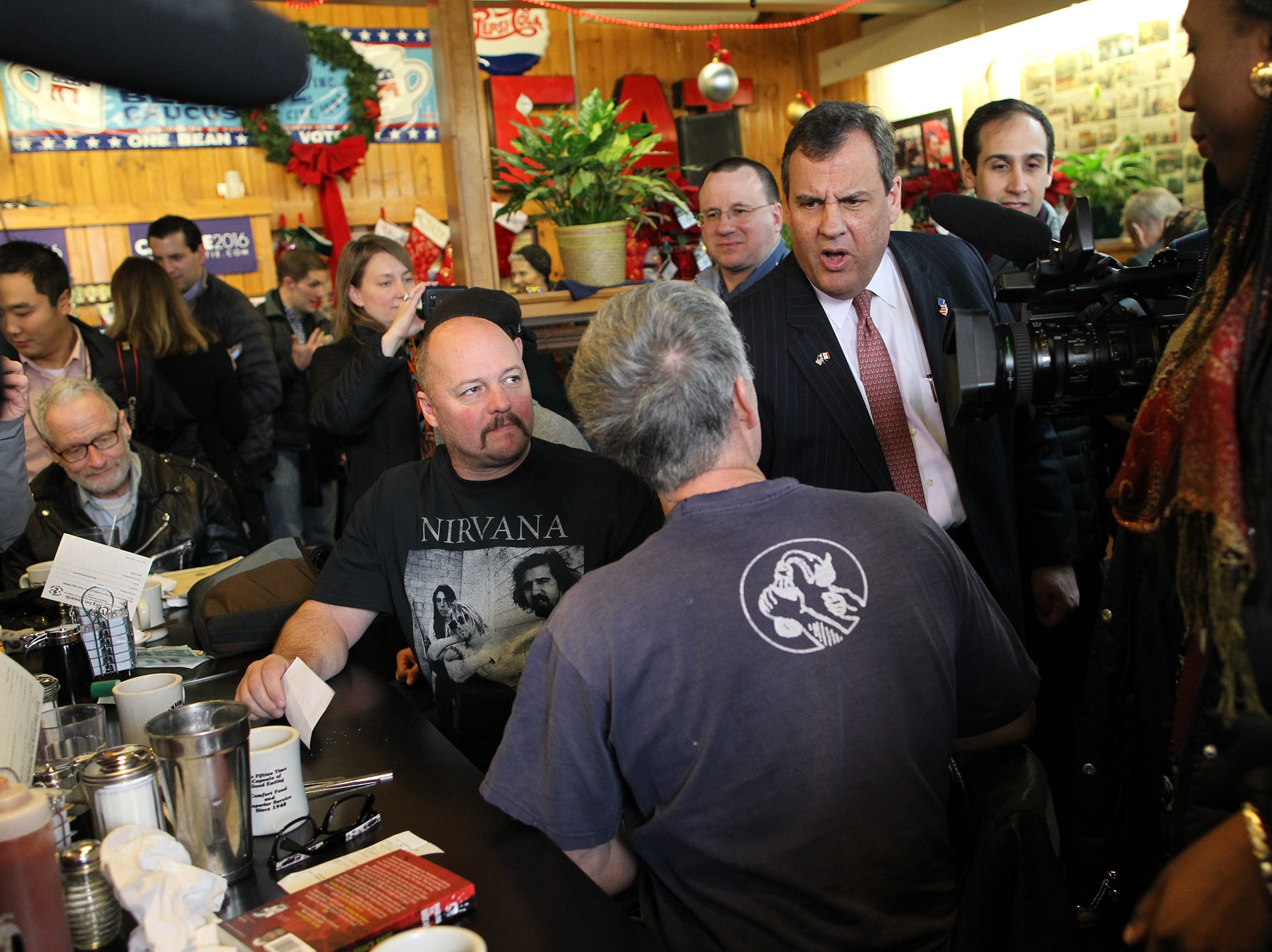 Republican presidential candidate Chris Christie greets guests at Hamburg Inn on Tuesday, Dec. 29, 2015.