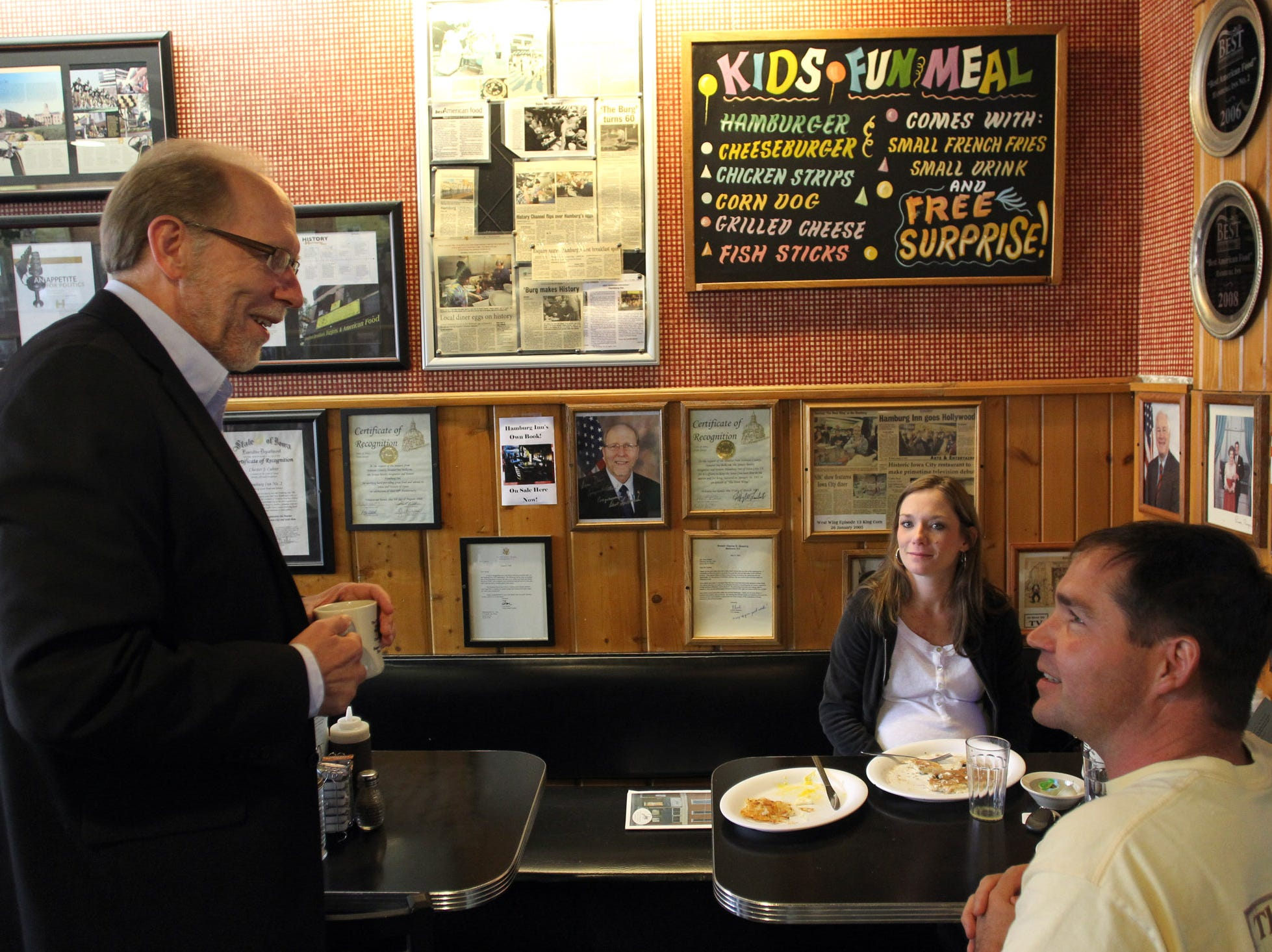 Rep. Dave Loebsack, D-Iowa, chats with Bree and Eric Colsch of North Liberty at Hamburg Inn on Thursday, Oct. 4, 2012.