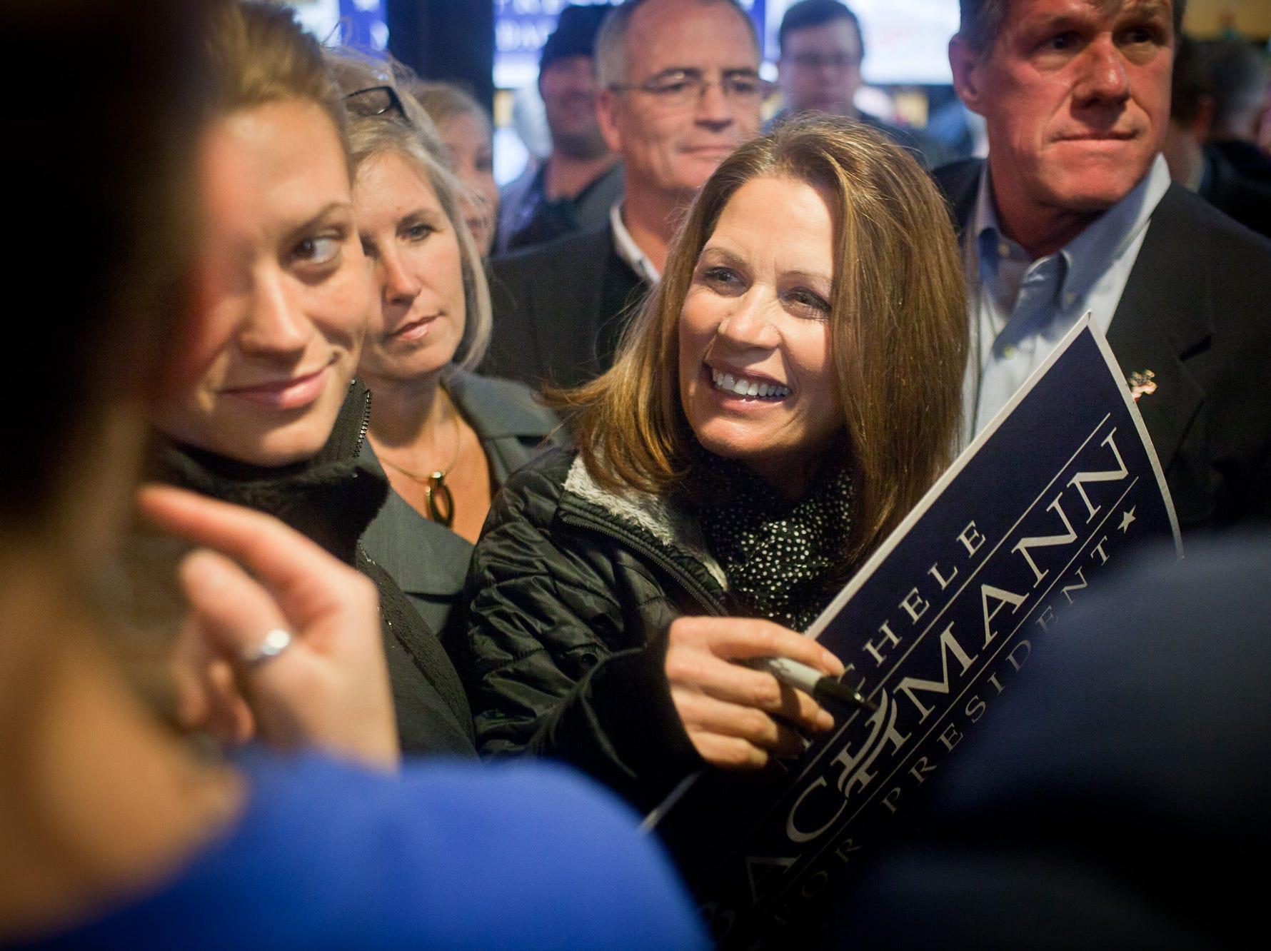 Rep. Michele Bachmann, R-Minn., talks with supporters at Hamburg Inn in Iowa City on Thursday, Dec. 22, 2011.