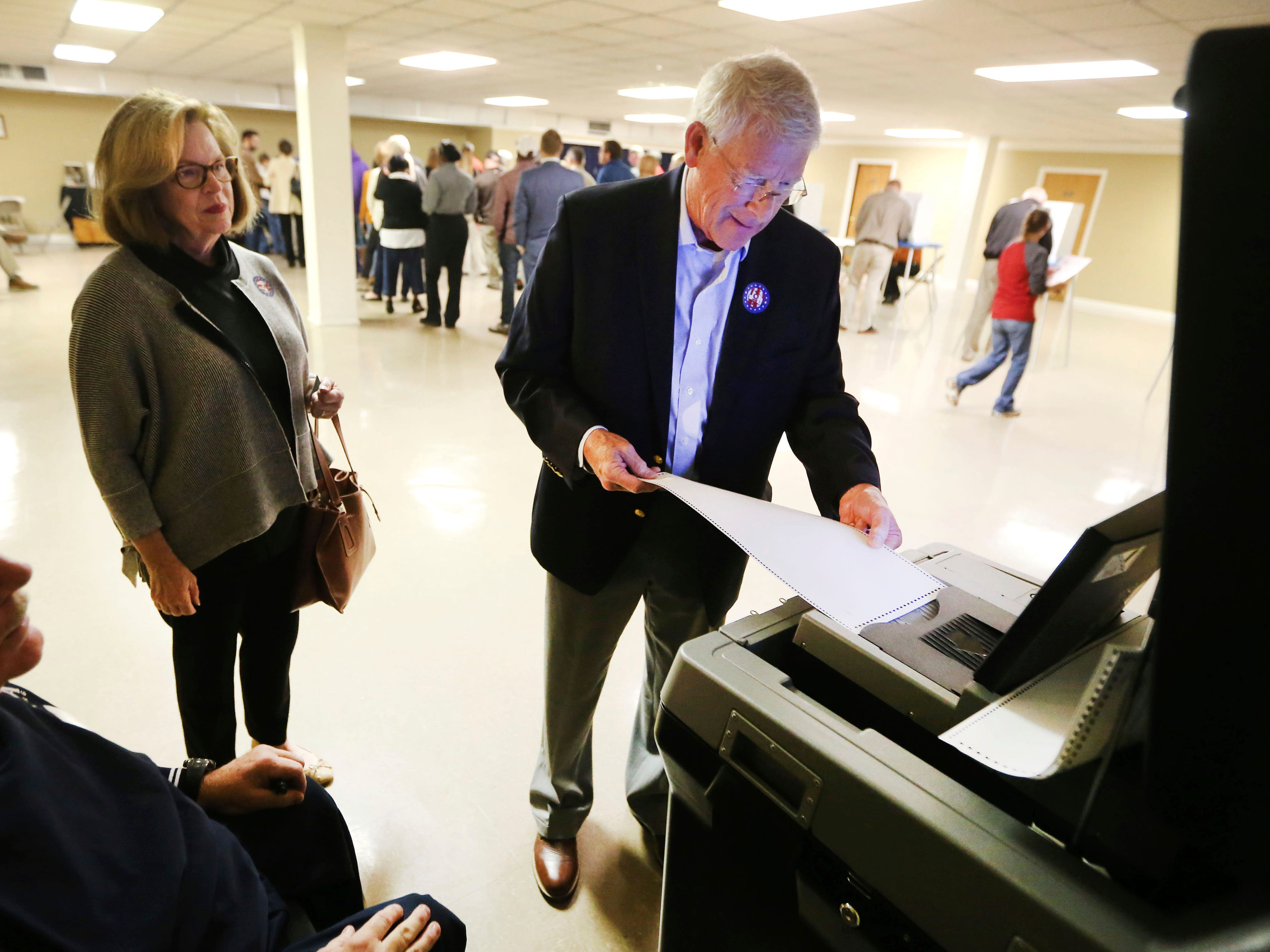 United States Sen. Roger Wicker, R-Miss., right, turns in his ballot with his wife Gayle Wicker by his side, after casting his vote in the midterm elections Tuesday, Nov. 6, 2018, in Tupelo, Miss. Wicker, who seeks reelection, faces several opponents, including State Rep. David Baria, D-Bay St. Louis.