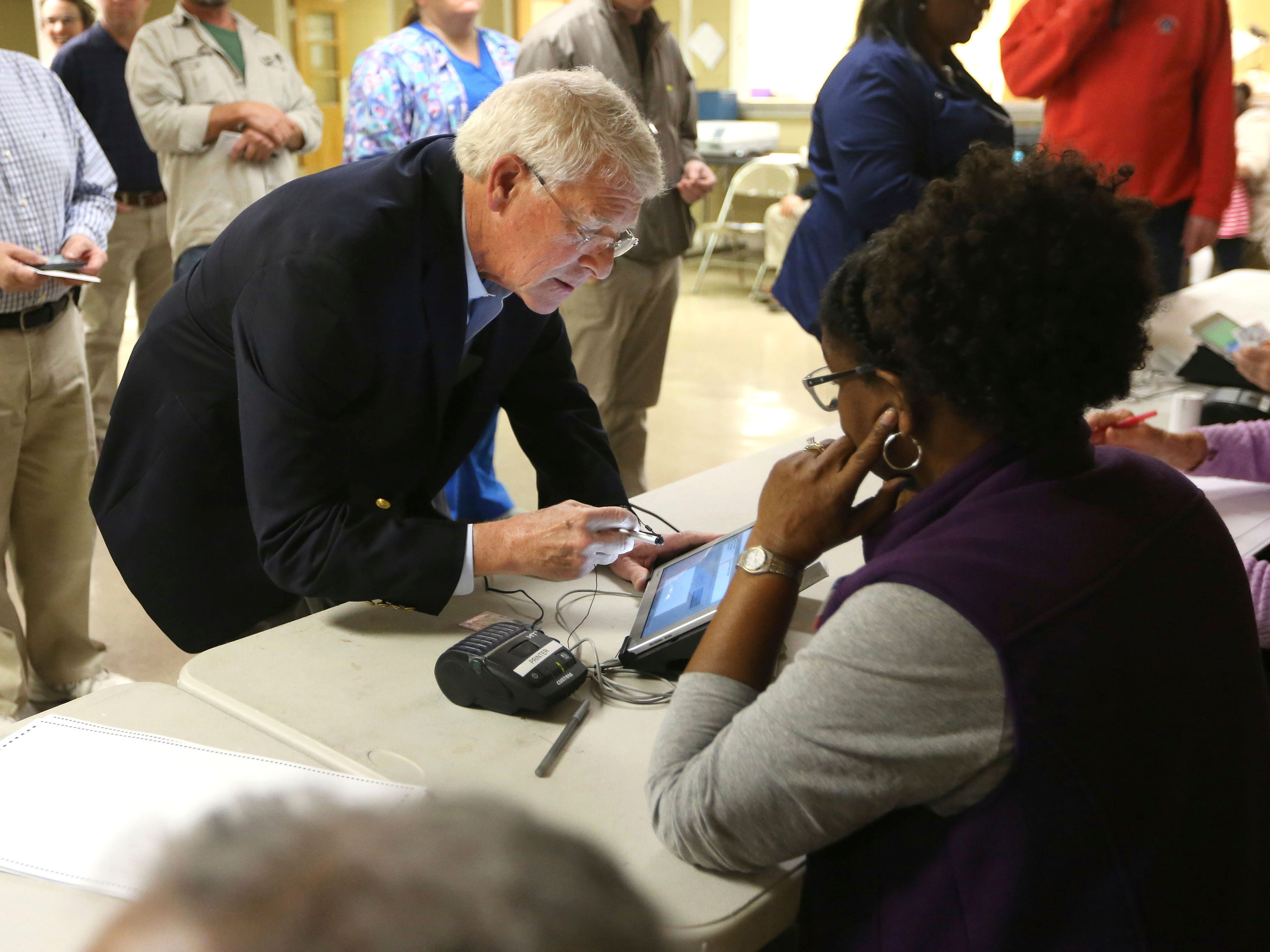 U.S. Senator Roger Wicker, R-Miss., signs in to vote in the midterm elections Tuesday morning, Nov. 6, 2018, in Tupelo, Miss. Wicker, who seeks reelection, faces several opponents, including State Rep. David Baria, D-Bay St. Louis.