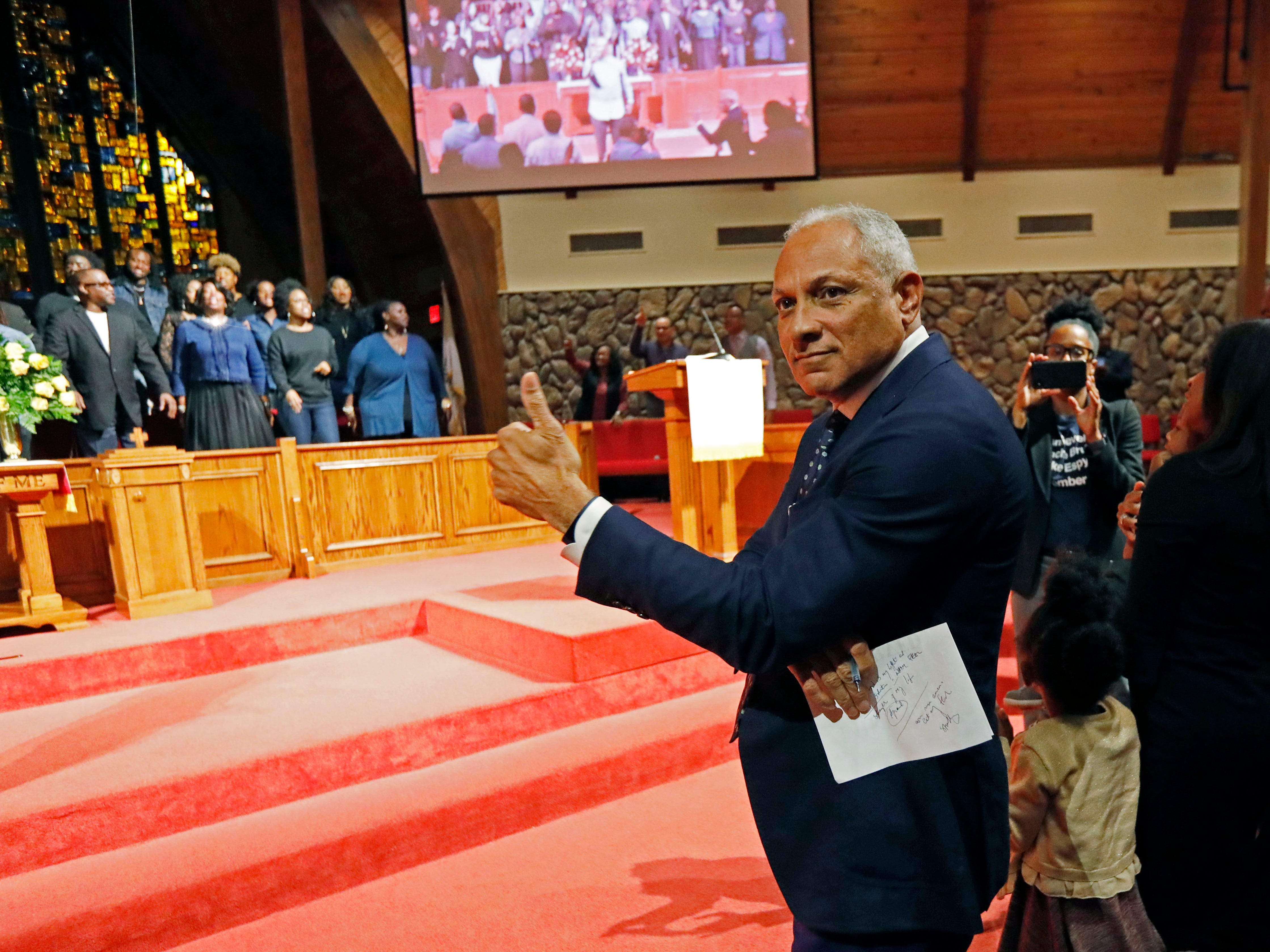 Former Democratic congressman and Agriculture Secretary under the Clinton Administration, Mike Espy gives a thumbs-up during a special performance of a choir in a rally at Anderson United Methodist Church in Jackson, Miss., Monday, Nov. 5, 2018.