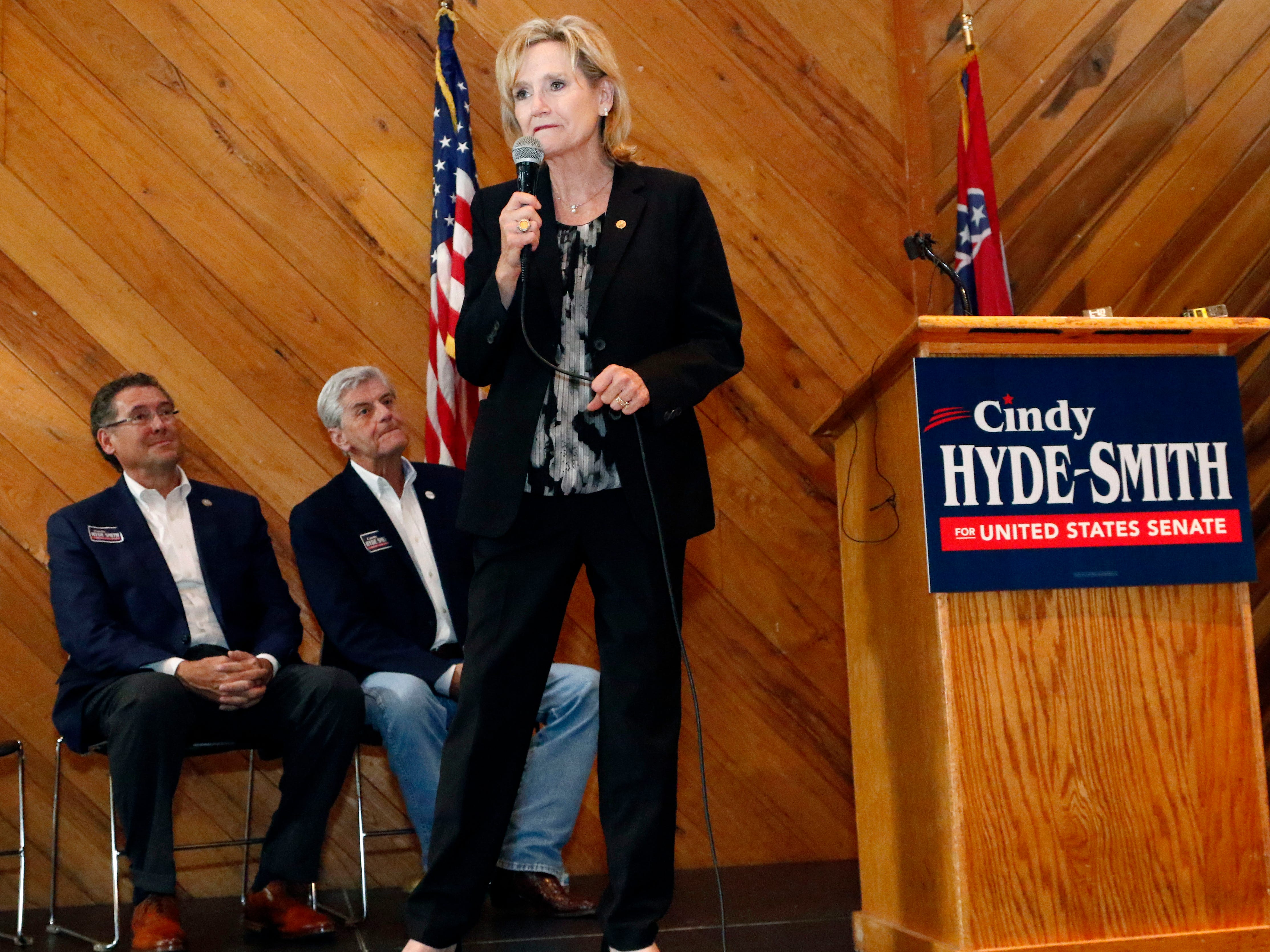 With U.S. Rep. Gregg Harper, R-Miss., left, and Gov. Phil Bryant, in attendance, U.S. Sen. Cindy Hyde-Smith, R-Miss., right, addresses a gathering of supporters in Jackson, Miss., Monday, Nov. 5, 2018.