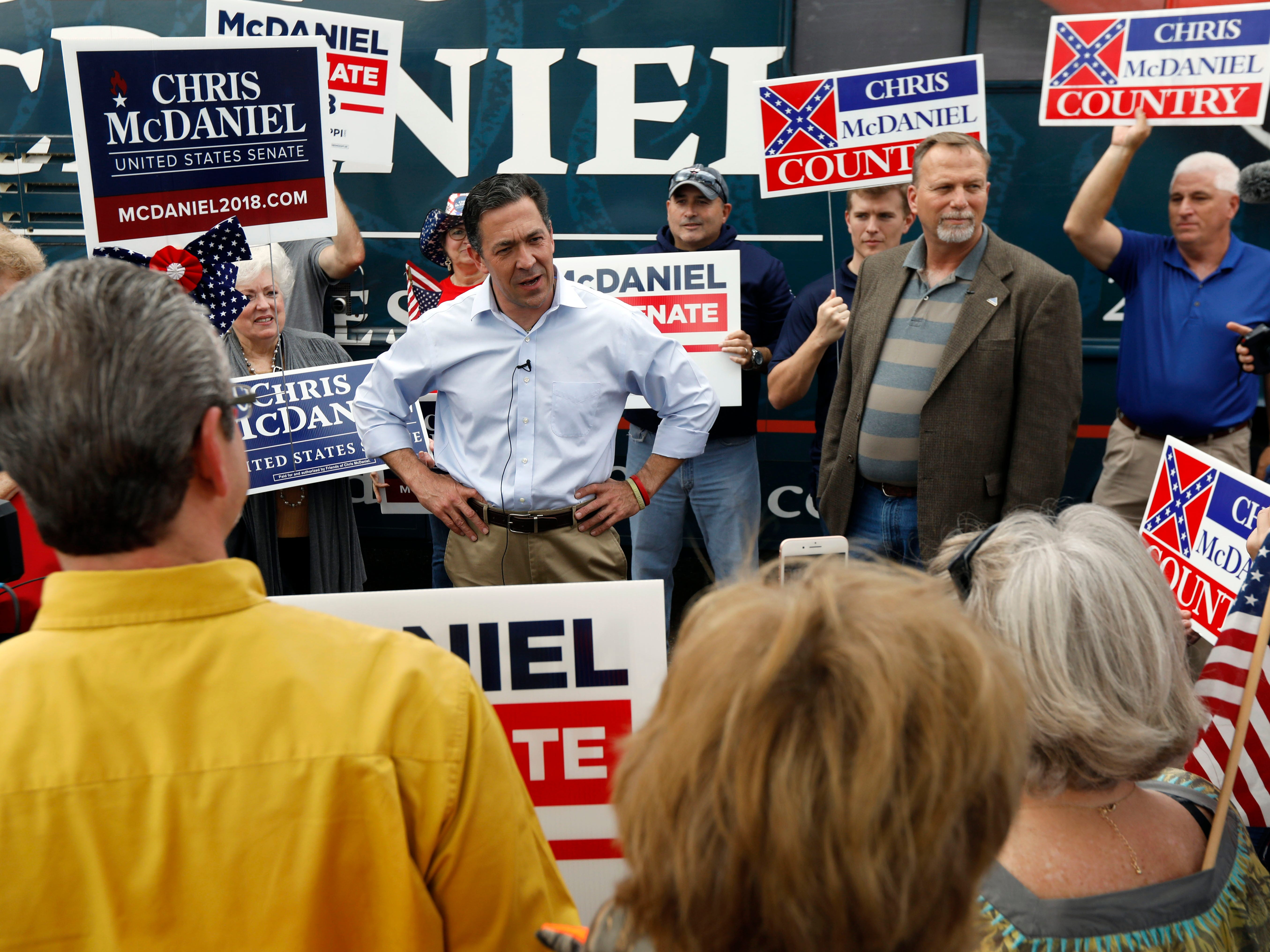 State Sen. Chris McDaniel, R-Ellisville, center, addresses the crowd at a shopping center in Flowood, Miss., Monday, Nov. 5, 2018. McDaniel hopes to unseat appointed U.S. Sen. Cindy Hyde-Smith, R-Miss., and serve the last two years of the six-year term vacated when Republican Thad Cochran retired for health reasons.