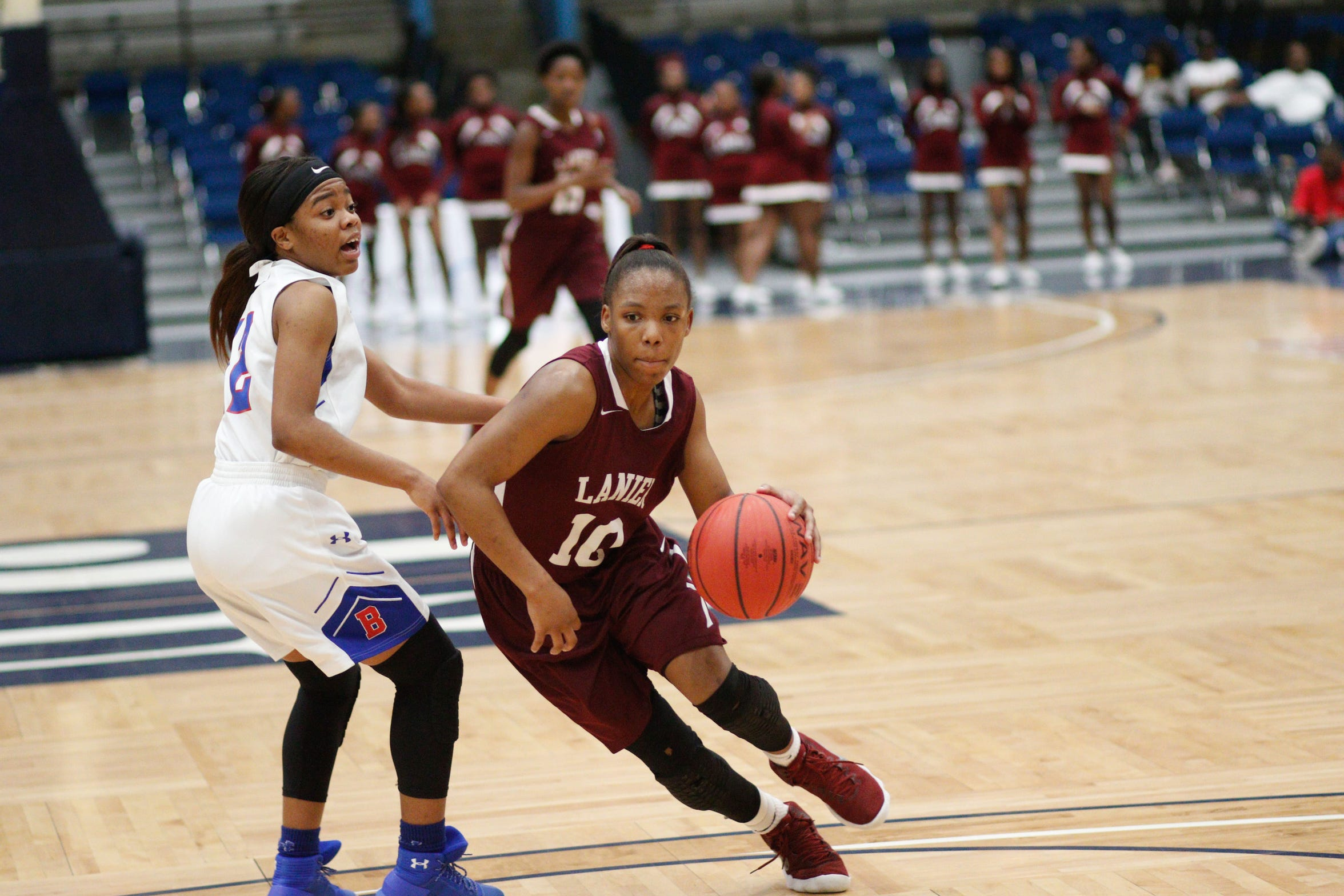 Keshunna Luckett (10), a member of the 2018-19 Dandy Dozen, dribbles past a defender during a game agains Byhalia on March 1, 2018, at Jackson State Univeristy in the Elite Eight round of the MHSAA 4A playoffs.