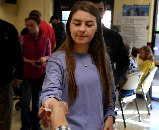 Abbey Hassell receives her access code so that she may vote for the first time during the 2018 midterm election, Tuesday, November 6.