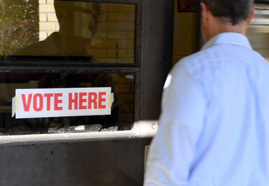 A Madison County voter walks into Pope Elementary School to to cast his ballot in the 2018 midterm election, Tuesday, November 6.