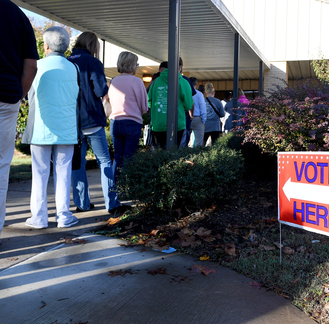 Madison County voters form a line outside of Pope Elementary School in Jackson to cast their ballots in the 2018 midterm elections, Tuesday, November 6.
