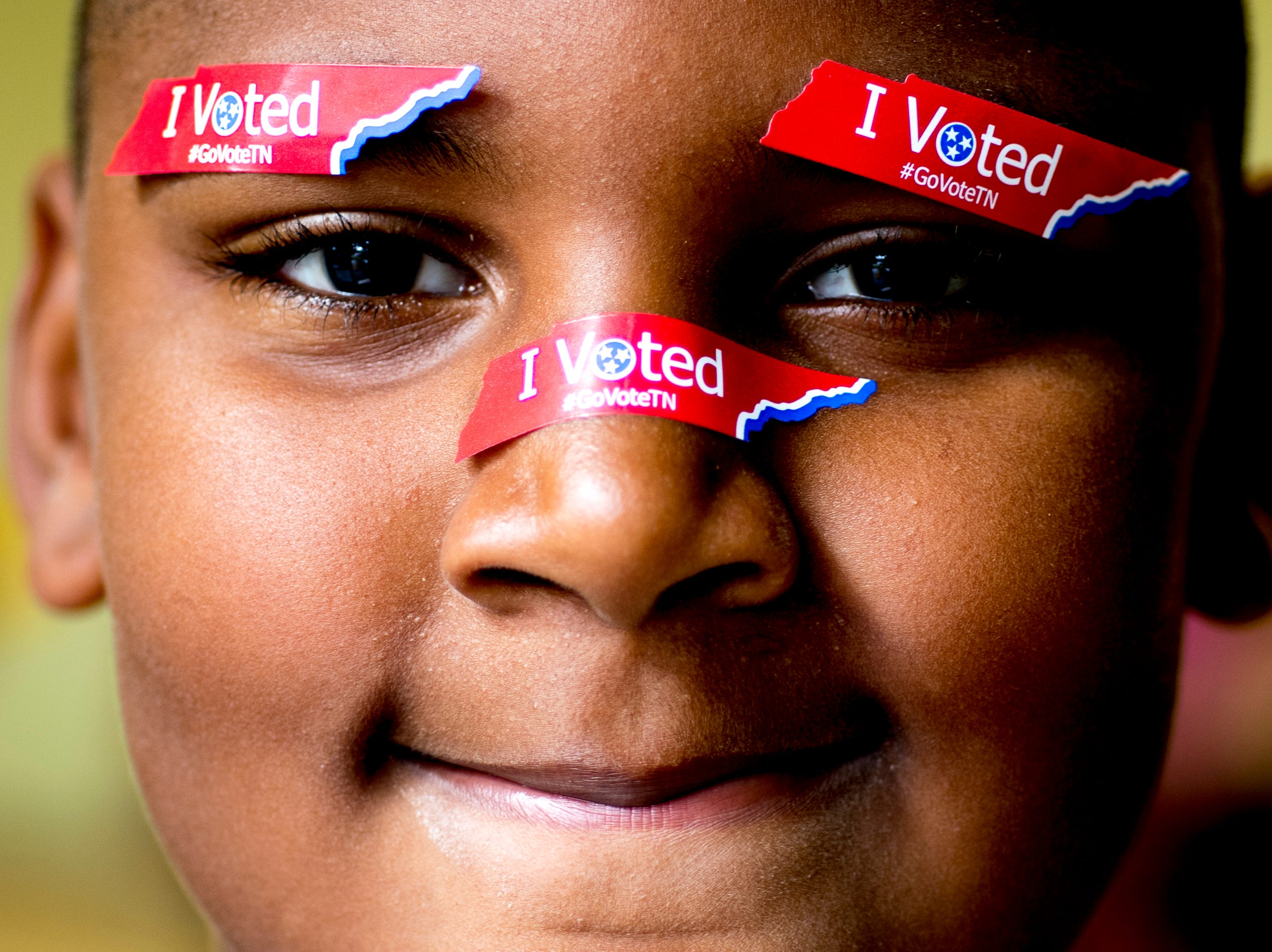 "Jy'Zayiah Davis, 9, of Knoxville, wears ""I Voted"" Tennessee stickers on his face while at Fair Garden Elementary School while his mom votes on Election Day in Knoxville, Tennessee on Tuesday, November 6, 2018. Voters were voting for Tennessee's next governor, U.S. senator, congressional representatives and dozens of state lawmakers."
