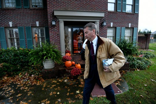 Tim Burchett leaves his home on Election Day Tuesday, Nov. 6, 2018 headed for multiple voting locations in multiple counties. His wife Kelley is at the door.