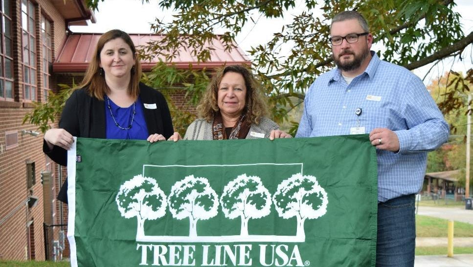 Meredith Nulton (left), Elaine Reed (center), and Nick Bridgeman (right) accepted the Tree Line USA award at last week's Arbor Day Celebration at West View Elementary School.
