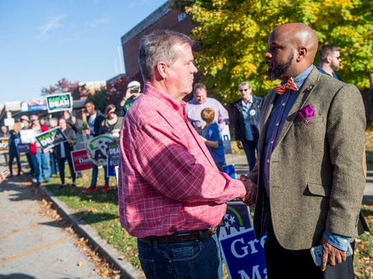 Gubernatorial candidate Karl Dean, left, shakes hands with Rick Staples, right, outside of Bearden High School on Election Day in Knoxville on Tuesday, November 6, 2018.