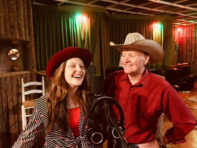 """Grant Maloy Smith and EmiSunshine sing in a recording studio, while they were working on """"Fly Possum Fly."""""""