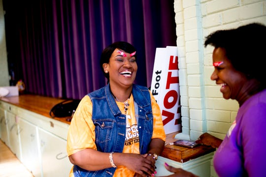 Nakia Scott, of Knoxville, shares a laugh with Joanne Dixon after voting at Fair Garden Elementary School on Election Day in Knoxville, Tennessee on Tuesday, November 6, 2018. Voters were voting for Tennessee's next governor, U.S. senator, congressional representatives and dozens of state lawmakers.