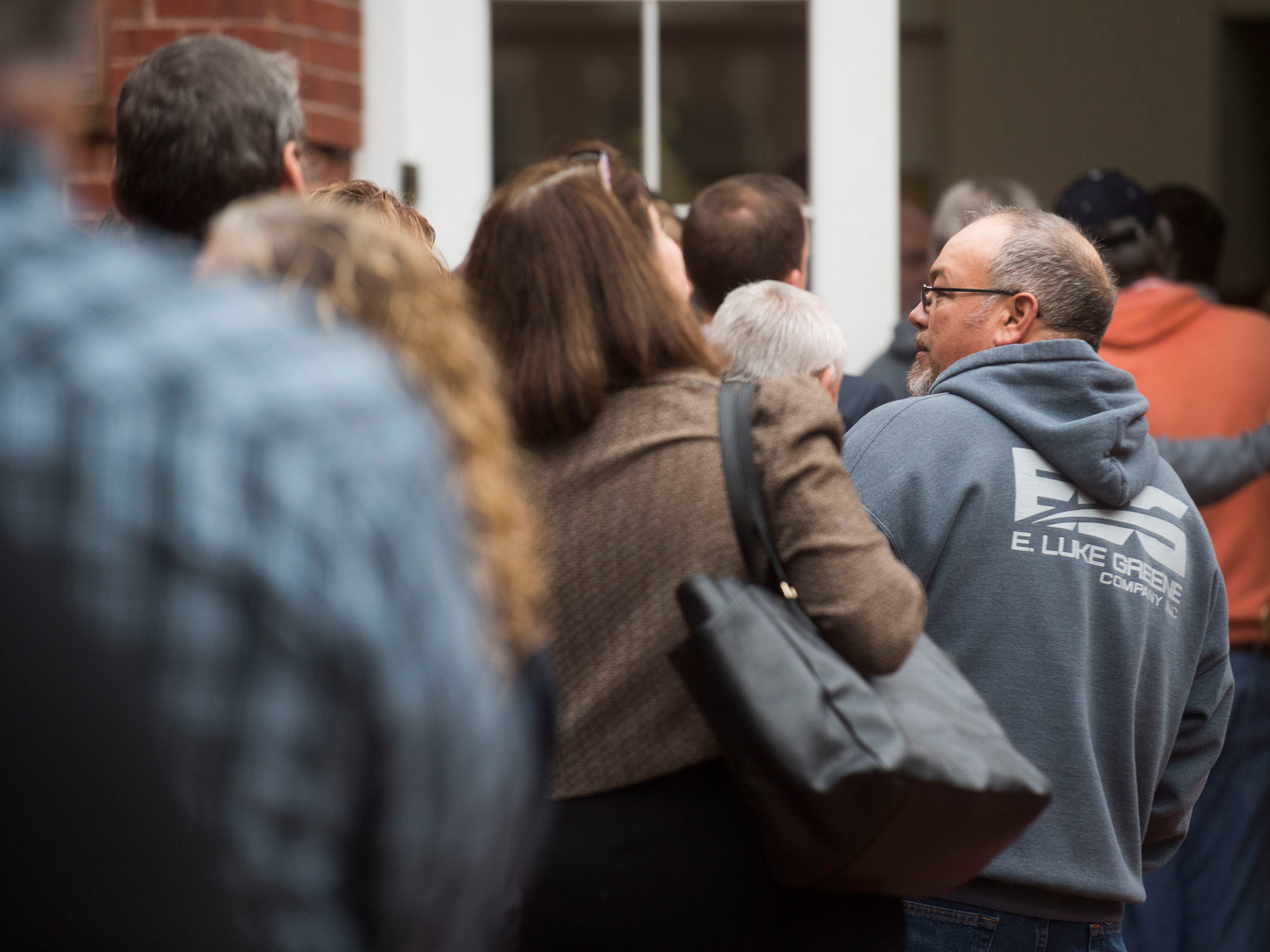 Kingston coal ash workers and others wait to enter the U.S. District Court before the closing arguments in a lawsuit by the sickened workers in Knoxville Tuesday, Nov. 6, 2018.