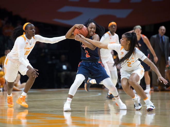 Tennessee's Meme Jackson, left, and Evina Westbrook press Carson-Newman's Briana Smith during an exhibition game at Thompson-Boling Arena on Monday.
