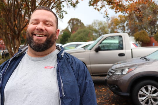 """Justin Sexton, a voter at Pleasant Ridge Elementary School, leaves the ballot box wearing a red """"I voted"""" TN sticker on Nov. 6."""
