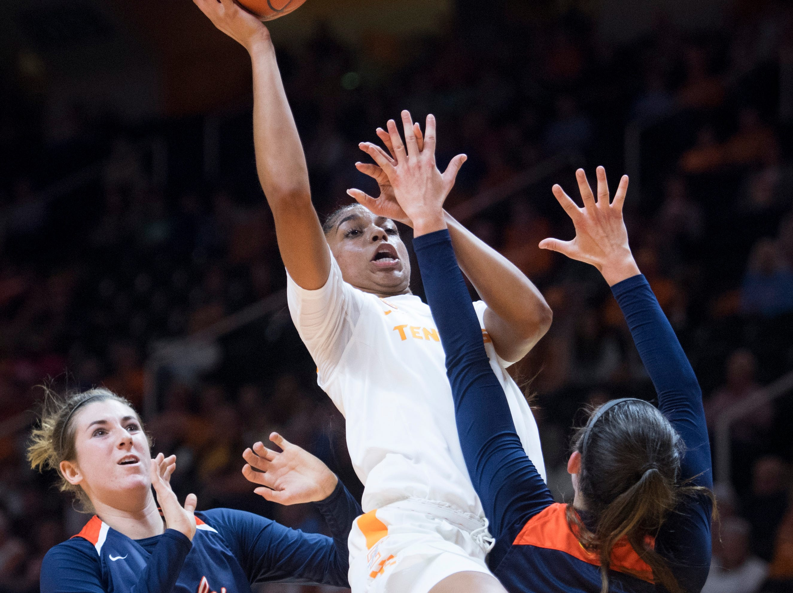 Tennessee's Evina Westbrook attempts to score over Carson-Newman's Kayla Marosites, right, and Mika Wester during an exhibition game at Thompson-Boling Arena on Monday, November 5, 2018.