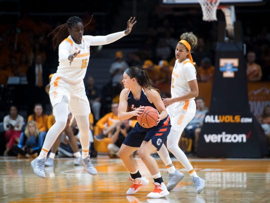Tennessee's Cheridene Green (15) and Rae Burrell (12) defend Carson-Newman's Kelci Marosites (4) in an exhibition game at Thompson-Boling Arena on Monday, November 5, 2018.