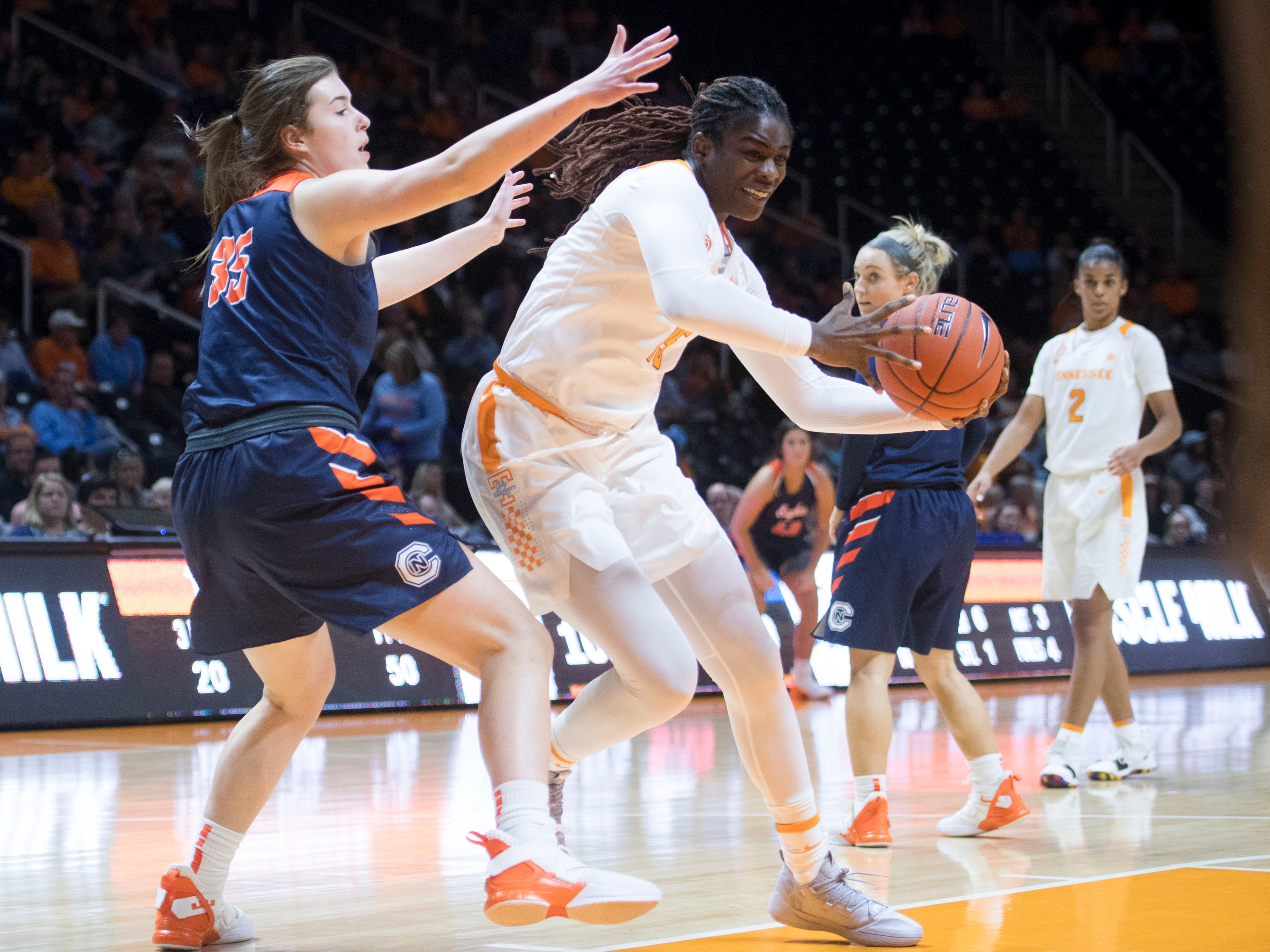 Tennessee's Cheridene Green (15) tries to get around Carson-Newman's Katie Bean (35) during an exhibition game at Thompson-Boling Arena on Monday, November 5, 2018.