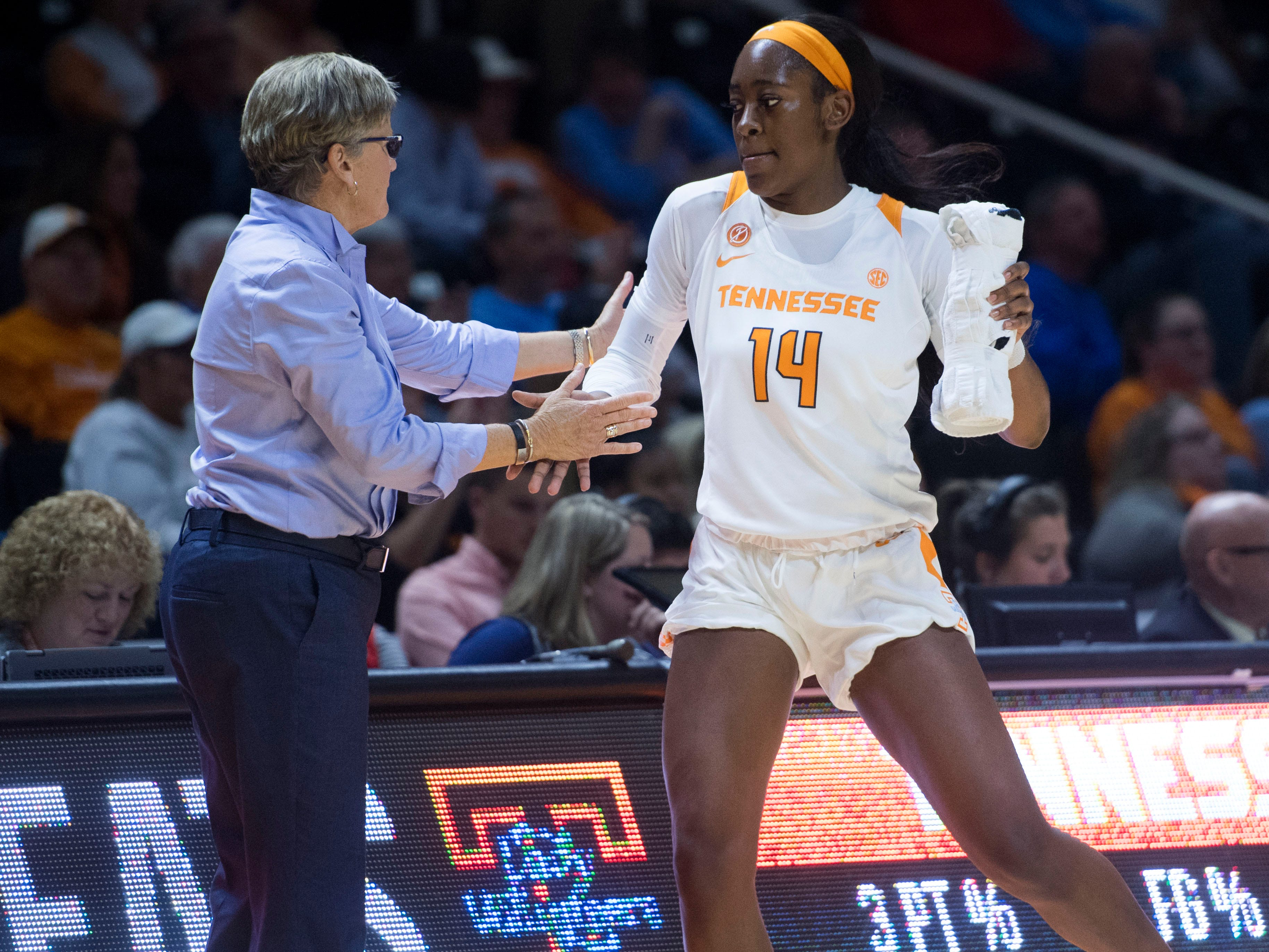 Tennessee's Zaay Green (14) is encouraged by Tennessee head coach Holly Warlick as she comes off the court during the exhibition game against Carson-Newman on Monday, November 5, 2018.