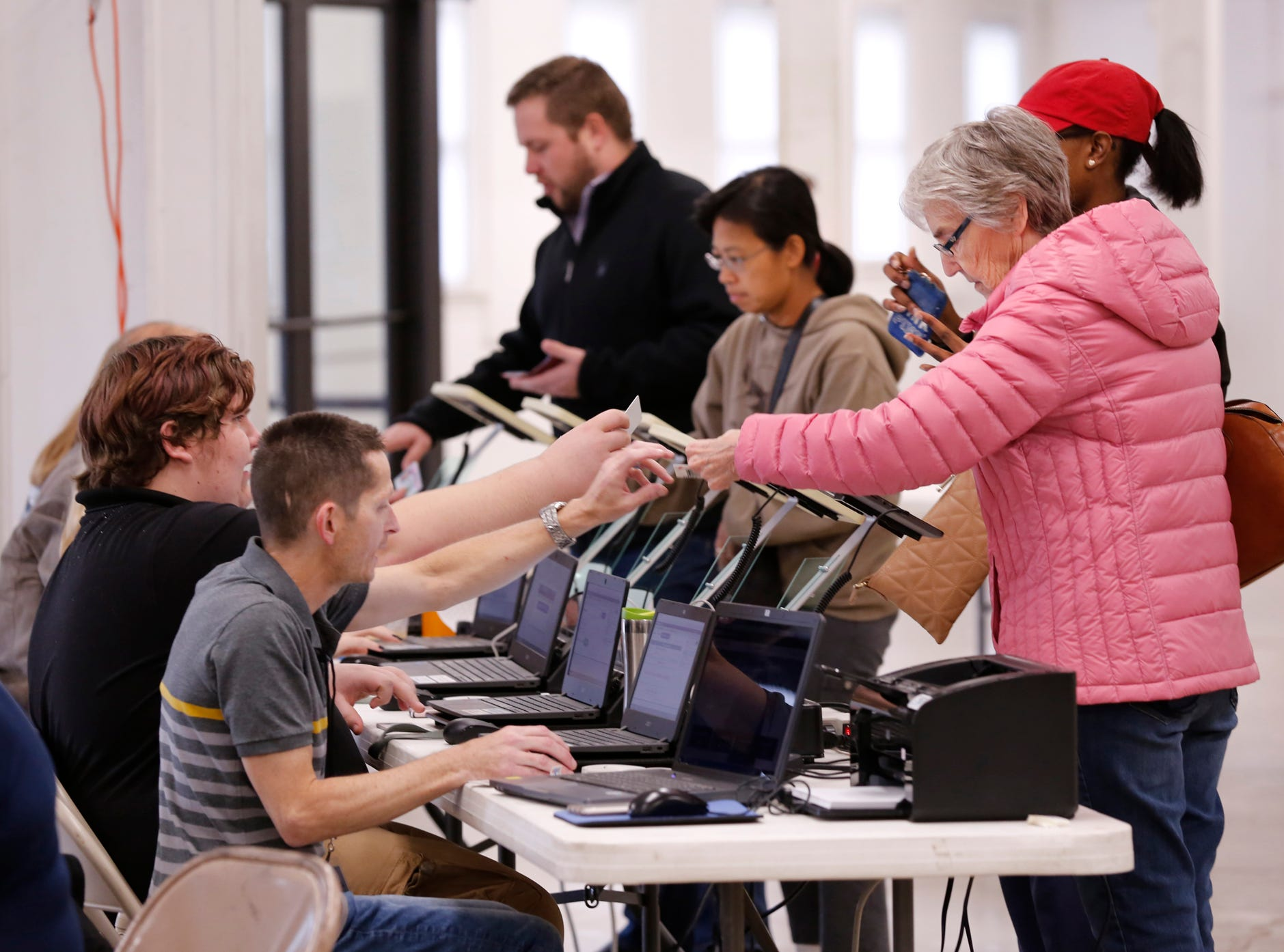 Residents check in before voting Tuesday, November 6, 2018, at the Tippecanoe County Fairgrounds in Lafayette.