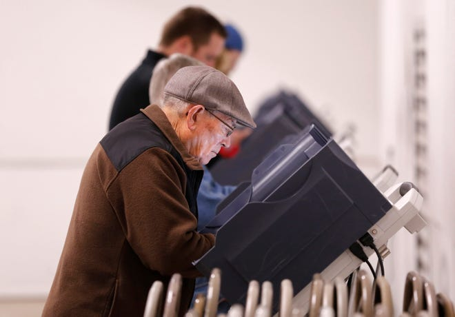Residents line up to vote Tuesday, November 6, 2018, at the Tippecanoe County Fairgrounds in Lafayette.