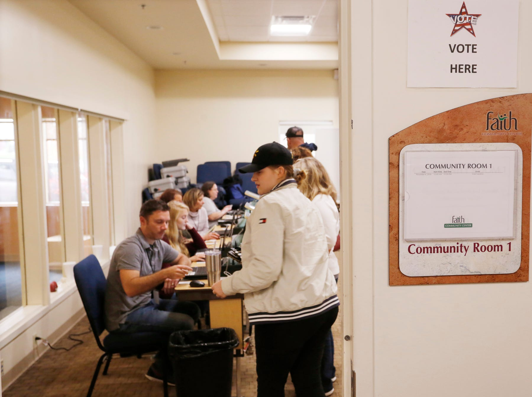Residents check in to vote at Faith Community Center Tuesday, November 6, 2018, in Lafayette.