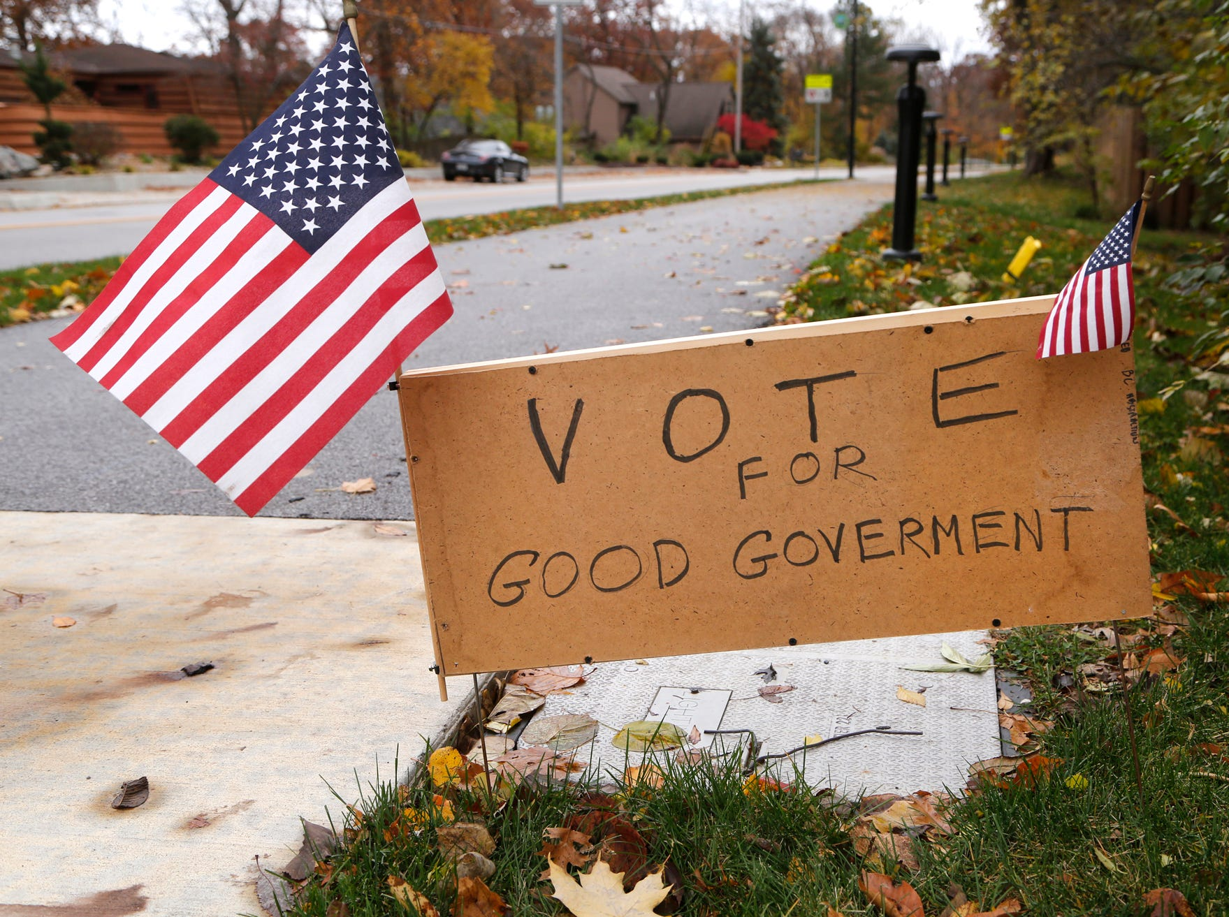 A sign posted on Happy Hollow Road encourages residents to exercise their right to vote Tuesday, November 6, 2018, in West Lafayette.