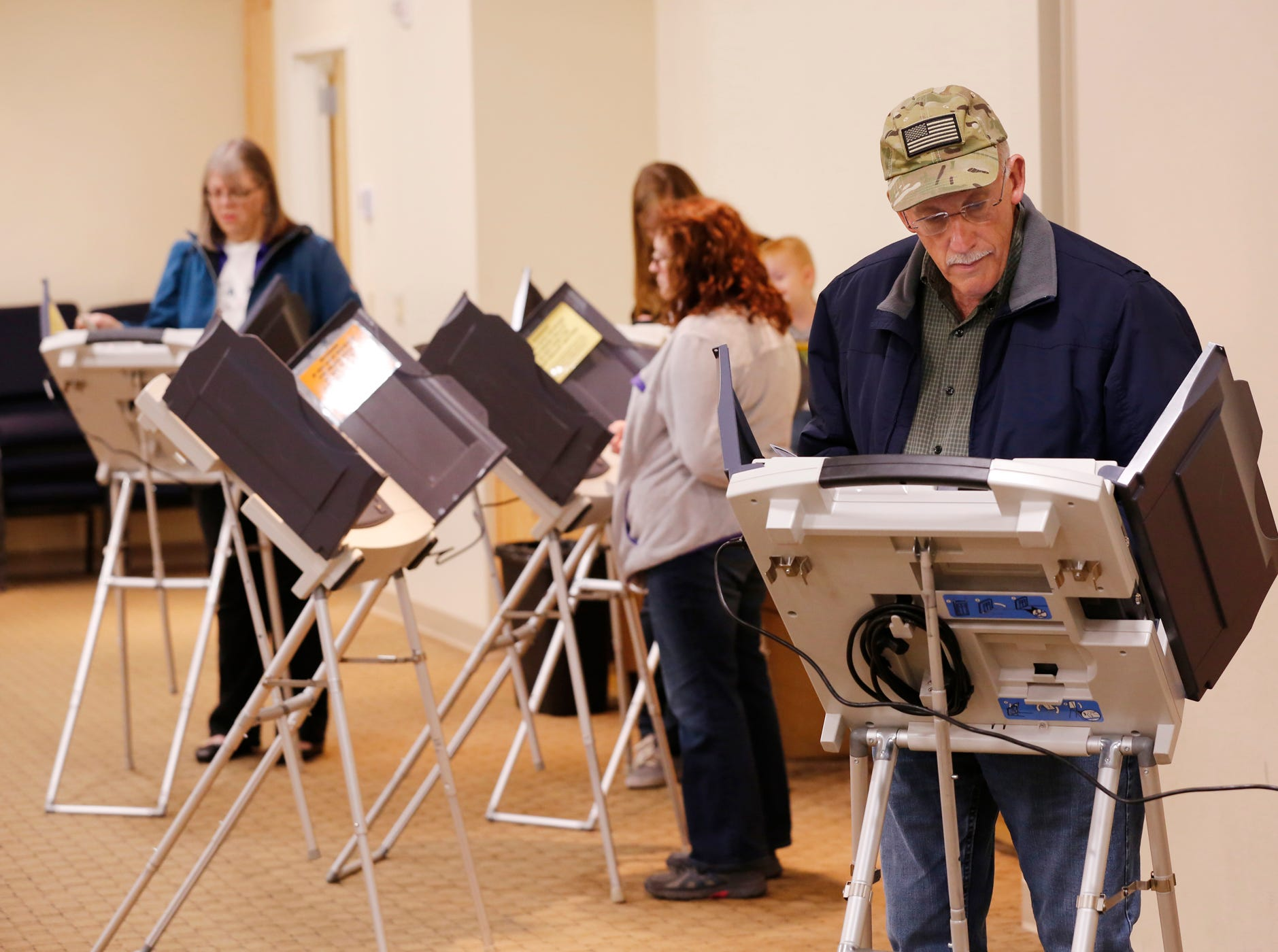 Residents cast their ballots at Faith Community Center Tuesday, November 6, 2018, in Lafayette.