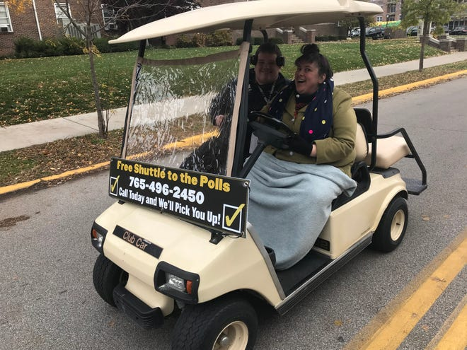 Melissa Gruver, right, associate director of civic engagement and leadership development, gives Purdue freshman Nate Holmer a lift from campus to the Morton Community Center Tuesday afternoon as part of the Purdue Office of Civic Engagement and Leadership Development free shuttle service to the polls for Election Day, Nov. 6, 2018.