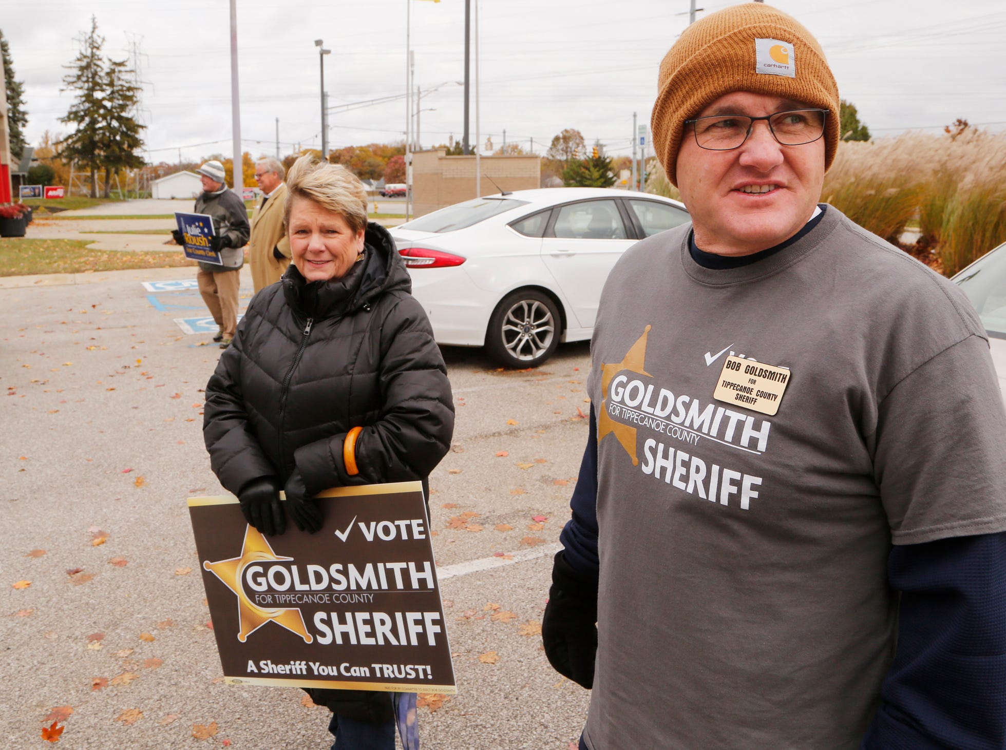 Democrat candidate for Tippecanoe County Sheriff Bob Goldsmith is joined by his mother Sherrie Cocanower  as he campaigns outside Lafayette Fire Department Station 5 Tuesday, November 6, 2018, in Lafayette.