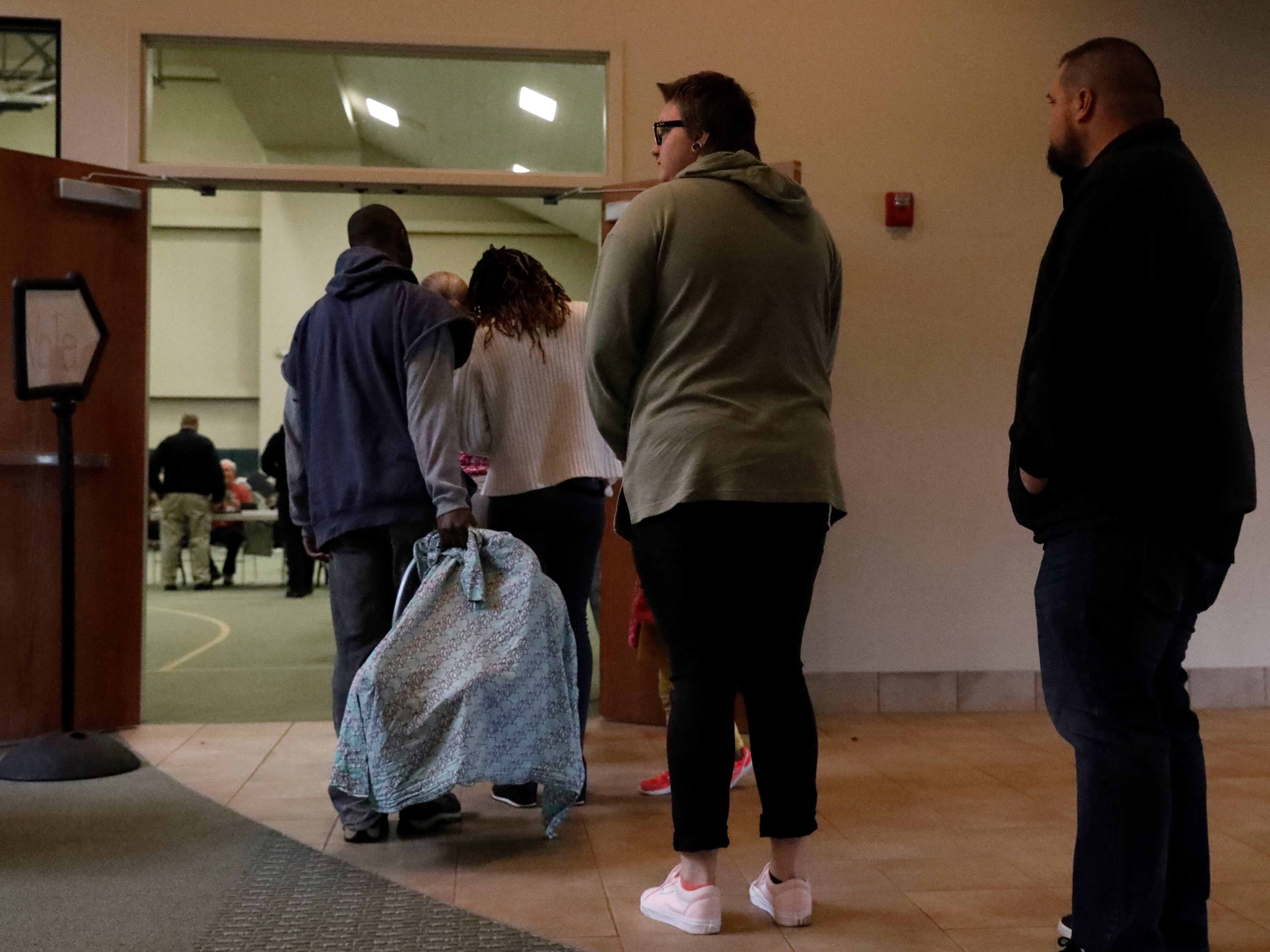 At midday voters had to wait in line for several minutes at the Crossroads Ministry Center Tuesday, Nov. 6, 2018, as they waited to vote in the midterm elections in Lancaster.