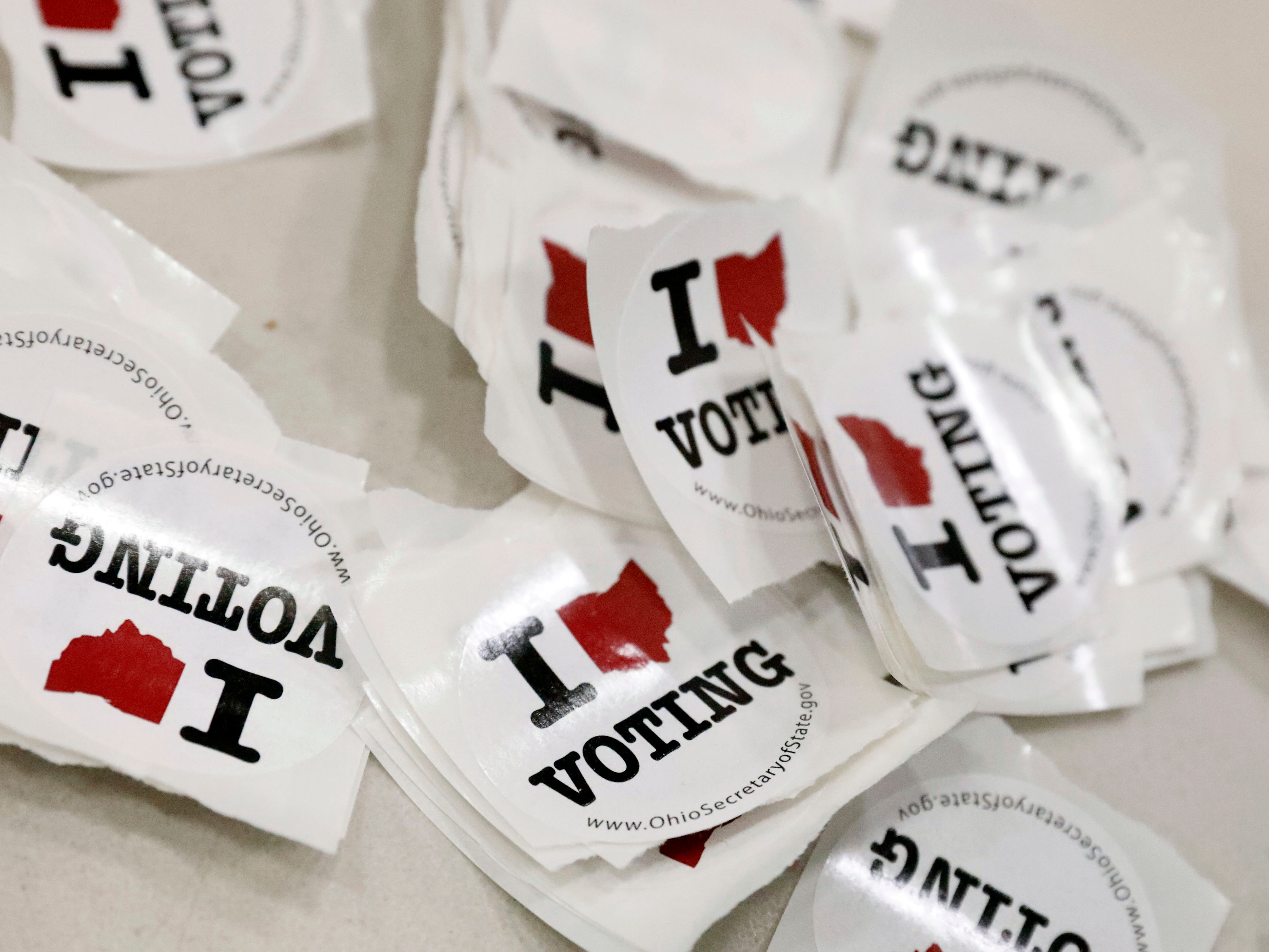 Voting stickers sit on a table at the Crossroads Ministry Center Tuesday, Nov. 6, 2018, in Lancaster.